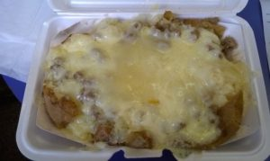 Baked Potato with sausage and mozzarella cheese